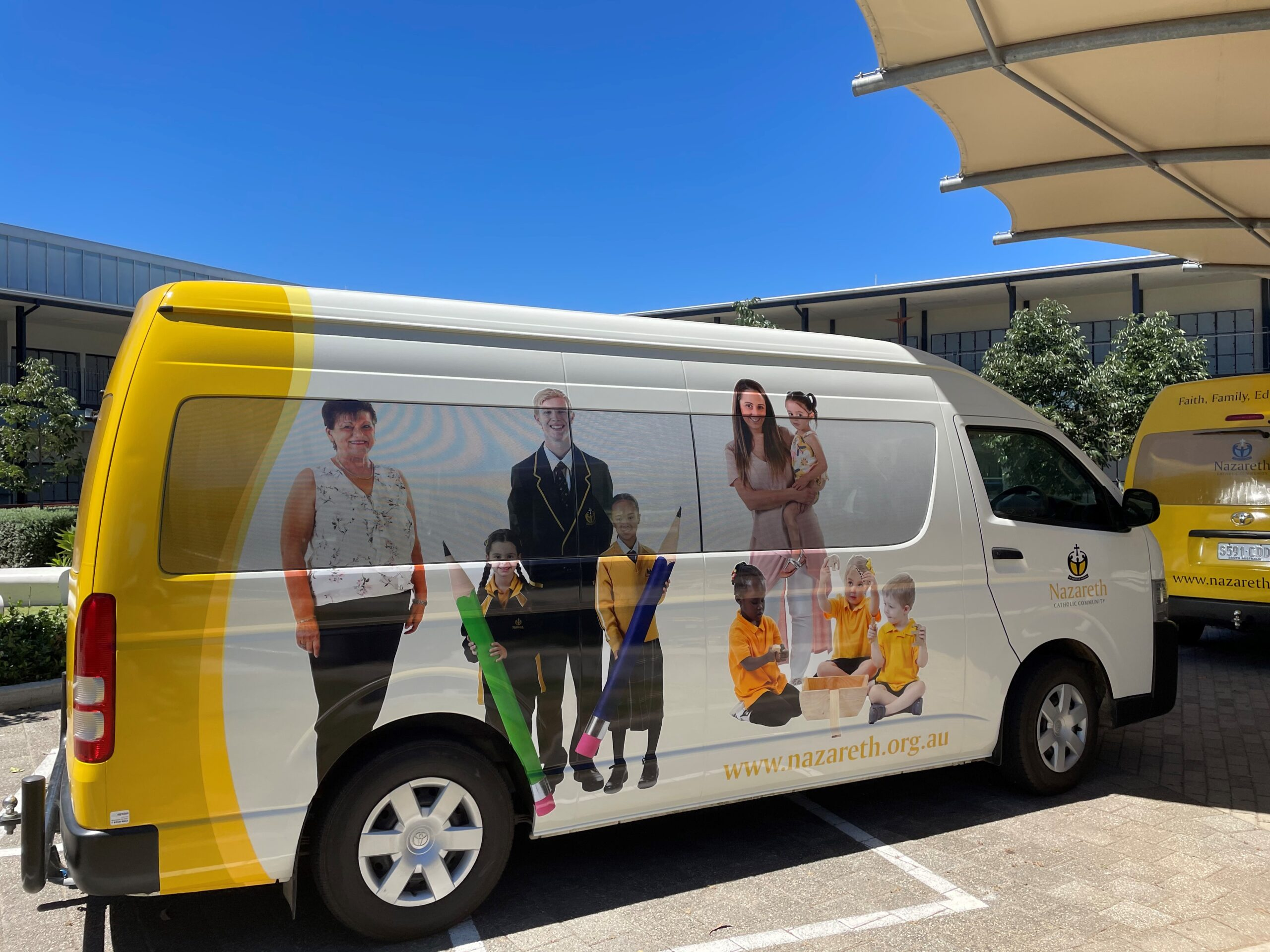 custom vehicle graphics and lettering on school bus Adelaide