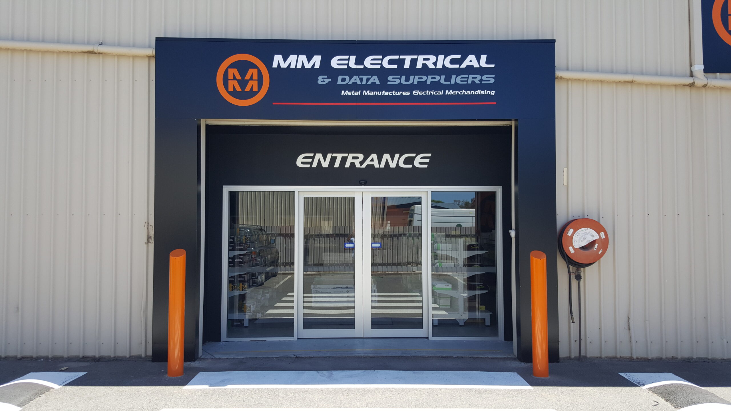 """Featured image for """"MM Electrical sparks new local presence with indoor and outdoor custom shop sign fit-out."""""""