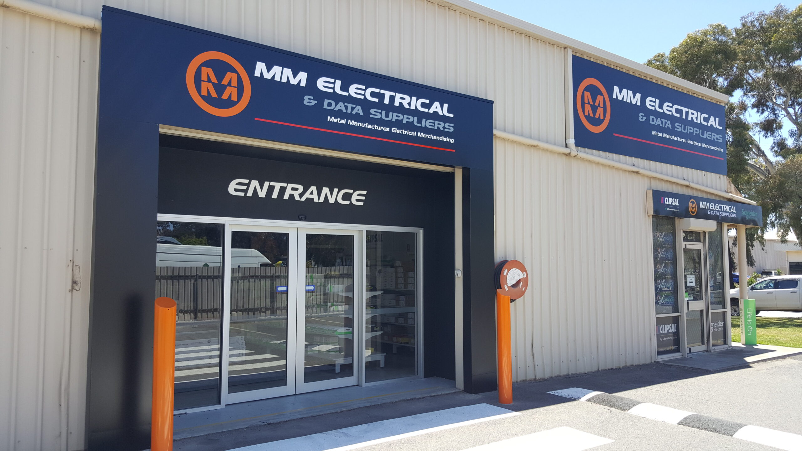 custom outdoor building signs installed on fascia Adelaide