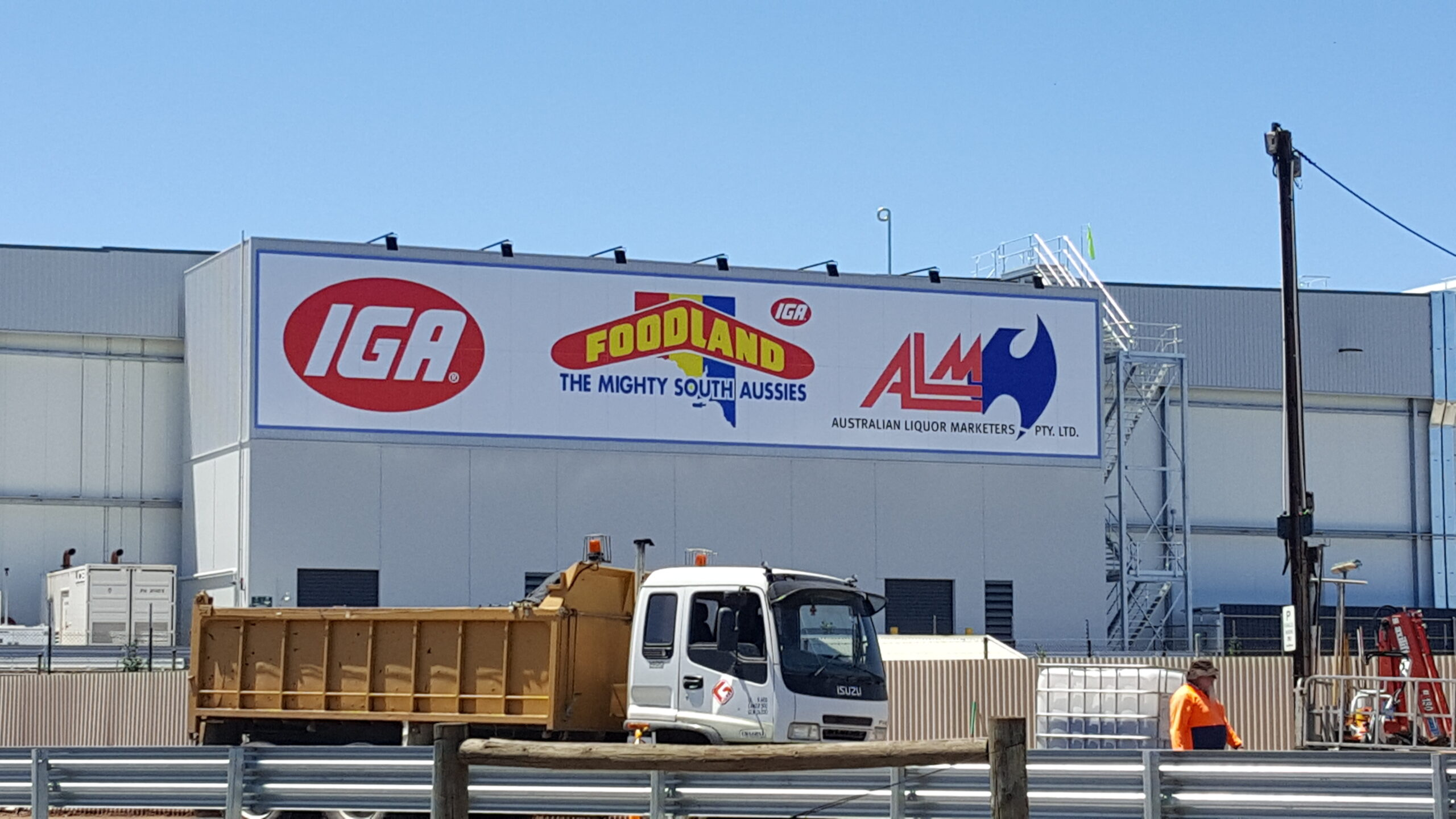 large format outdoor business sign on building fascia in Adelaide